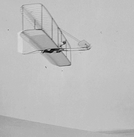 Wilbur Wright flying in his glider